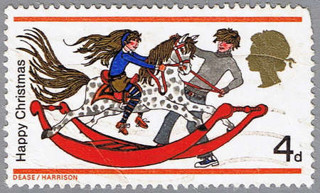 GREAT BRITAIN � CIRCA 1968: A stamp printed in Great Britain shows children playing on a toy rocking horse, series is devoted to Christmas, circa 1968 photo