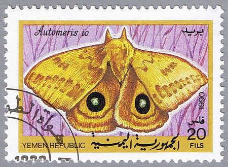 YEMEN REPUBLIC - CIRCA 1990: A stamp printed in Yemen Republic shows Automeris io, series devoted to butterflies, circa 1990 Stock Photo - 10811284