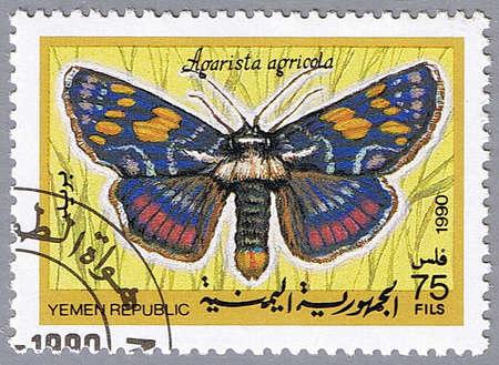 timbre postal: República del YEMEN - alrededor de 1990: Un sello impreso en la República del Yemen muestra Agarista agricola, serie dedicada a las mariposas, alrededor de 1990 Foto de archivo