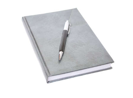 The diary and pen on a white background photo