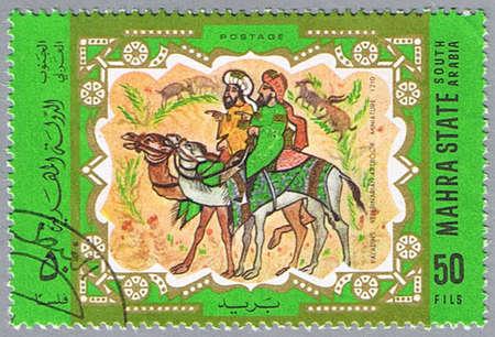 camel post: MAHRA STATE - CIRCA 1967: A stamp printed in Mahra State shows Persian Miniature, series, circa 1967 Stock Photo