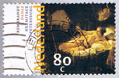 rembrandt: NETHERLANDS - CIRCA 1999: A stamp printed in Netherlands shows �Danae� by Rembrandt, series, circa 1999