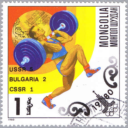 MONGOLIA - CIRCA 1980: A stamp printed in Mongolia shows weightlifter, series devoted Olympic Games in Moscow, circa 1980