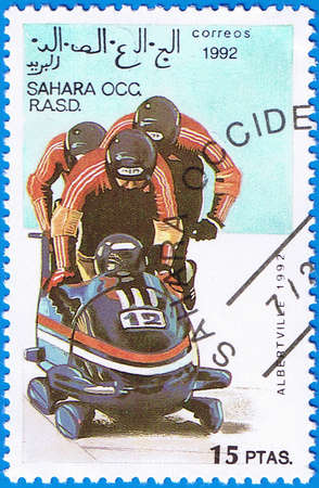 WESTERN SAHARA - CIRCA 1992: A stamp printed in Western Sahara shows bobsleigh, series devoted Olympic Games in Albertville, circa 1992