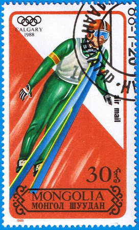MONGOLIA - CIRCA 1988: A stamp printed in Mongolia shows jumps from a springboard, series devoted Olympic Games in Calgary, circa 1988 Stock Photo - 12256347