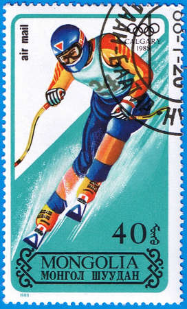 MONGOLIA - CIRCA 1988: A stamp printed in Mongolia shows mountain-skier, series devoted Olympic Games in Calgary, circa 1988 Stock Photo - 12256345