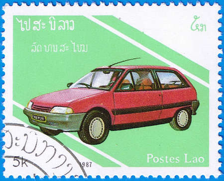 LAOS- CIRCA 1987: A stamp printed in Laos shows Renault 5, series is devoted to cars, circa 1987 Editorial