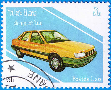 LAOS- CIRCA 1987: A stamp printed in Laos shows Rover 800, series is devoted to cars, circa 1987