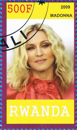 famous women: RWANDA - CIRCA 2009: A postage stamp printed in the Republic of Rwanda showing Madonna Louise Ciccone, circa 2009 Editorial