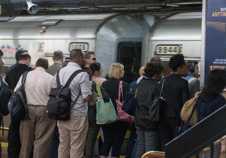 New York City, Circa 2017: Manhattan commuters wait for Long Island Railroad LIRR train to arrive at Penn Station underground transit terminal 新闻类图片