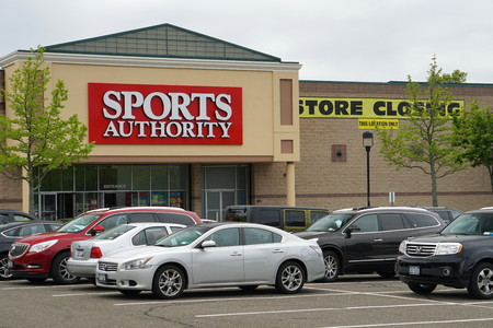 Commack, NY - May 22, 2016: Sports Authority store closing inventory liquidation after company files for chapter 11 bankruptcy. Children choose video games and mobile technology over physical activity