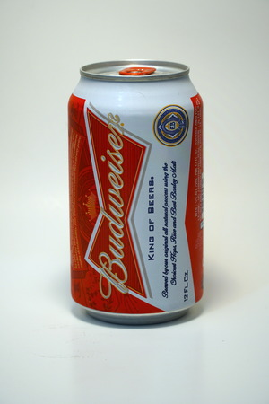 Budweiser beer can.  American style pale lager alcoholic beverage produced by brewer Anheuser Busch in United States - Illustrative Editorial.