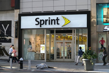 New York City - September 2016: People walk past Sprint store in Manhattan. Mobile phone cellular corporation is a telecommunications company that provides wireless services.