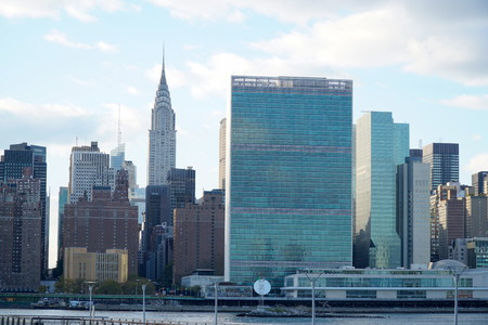 New York City - October 2016: Chrysler Building and United Nations Buildings stock photo taken from Queens across the East River
