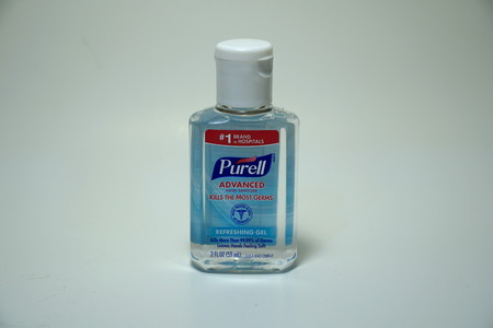 Purell hand sanitizer - product photo. Made of ethyl alcohol which claims to kill 99.99% of common germs. Common use in hospitals and doctors offices Illustrative Editorial Редакционное