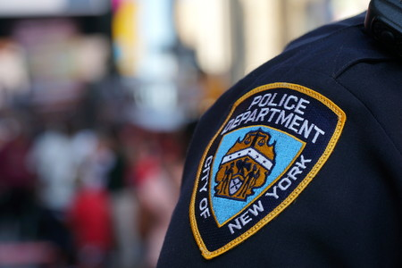 New York City - September 2016: NYPD sleeve patch shield on a police officer patrol in Manhattan. Protect public from terror threats and ensure safety in popular city and target for attacks. Editorial