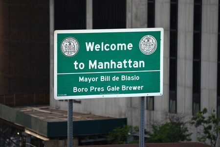 New York City, NY - June 7, 2016: Welcome to Manhattan traffic road sign on the Brooklyn Bridge