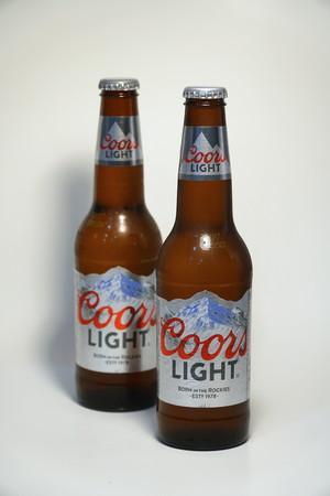 Coors light beer bottle against white background product shot coors light beer bottle against white background product shot silver bullet alcoholic drink branded aloadofball Images