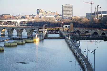 Locks and Dams along the Mississippi River in Minneapolis Minnesota. Help shipping boats navigate down the waterway