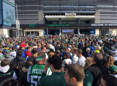 East Rutherford, NJ - October 2016: New York Jets fans crowd into entrance of Metlife Stadium to cheer football team against Balitmore Ravens opponent on Sunday gameday