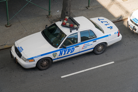 New York City, Circa 2017: NYPD police department cruiser car vehicle parked on road patrol. Overhead view day time Editorial
