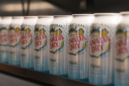 New York City, Circa 2017: Canada Dry Seltzer cans in a row on refrigerated shelf at food market super store for customer selection. Illustrative Editorial