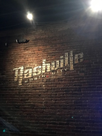 Nashville Music City sign on a brick wall background in Tennessee