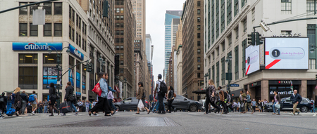 New York City, Circa 2017: Manhattan crosswalk intersection low angle panorama view. Outside Macys herald square Citibank day time exterior photo. People safety crossing street Sajtókép