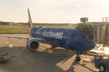 New York, USA - Circa 2018: Southwest airlines Boeing 737 airplane at terminal gate boaring passengers for early morning flight departure Stock Photo - 109379003