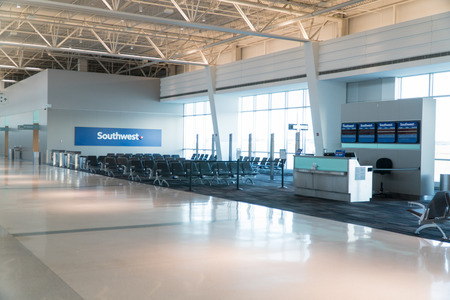 Long Island, NY - Circa 2018: Southwest Airlines empty passenger terminal gate at Islip airport no people. Check in location before boarding airplane to travel to destination Stock Photo - 109379006