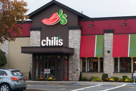 New York, USA - Circa 2018: Chilis bar and grill mexican tex mex family restaurant exterior facade store front. view from shopping center parking lot.
