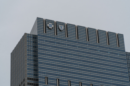 Chicago, USA - Circa 2019: Blue Cross Blue Shield commercial real estate building corporate headquarters downtown with emblem logos on top of building facade. 新闻类图片