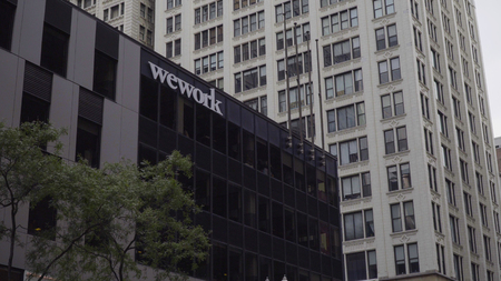 Chicago, USA - Circa 2019: Wework american real estate company provide shared work space for technology start up businesses 新闻类图片