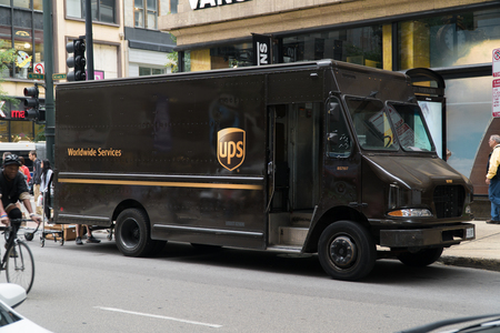 Chicago, USA - Circa 2019: United Parcel Service UPS famous brown logo truck parked on city street deliver package to local business and residence