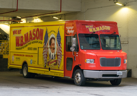 Chicago, USA - Circa 2019: WB Mason delivery truck parked outside building on route bring stationary and office supplies to businesses at headquarters