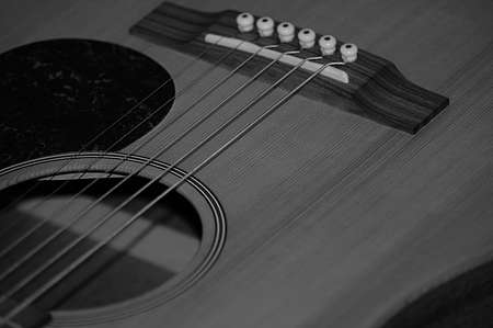Black and white accoustic guitar close up