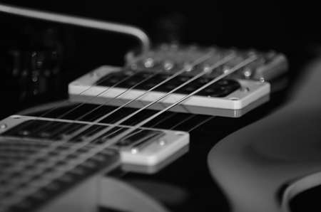 Black and white picture of guitars lines