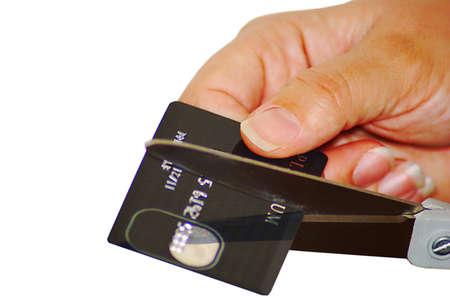Woman cutting up credit card. photo