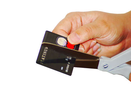 Woman cutting up credit card with scissors. photo