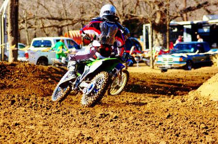 dirt bike: Dirt bike rider trying to make the pass.