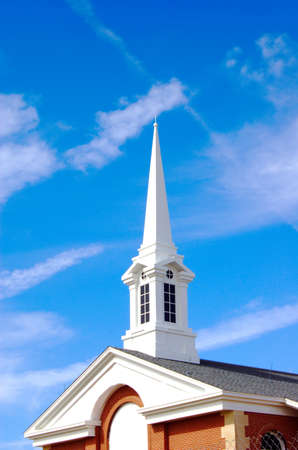 Church steeple with blue sky background Stock Photo
