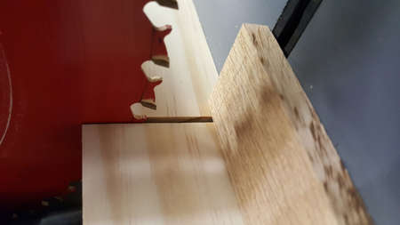 Cutting wood on table saw Stock Photo