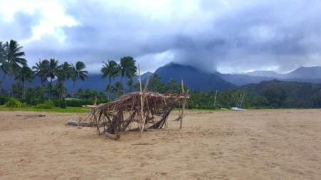 Local beach hut in sand