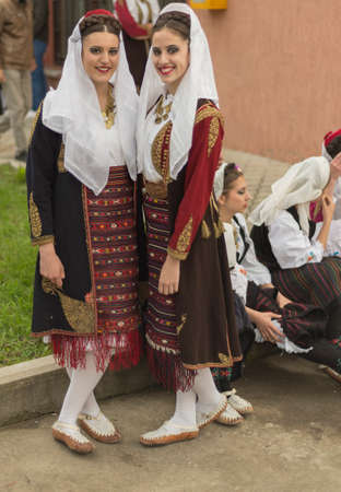 folk music: Pozarevac,Serbia-May 2,2016: Girls in   serbian folk  costume  smiling  on  folk  music  festival in city called Pozarevac  on  spring