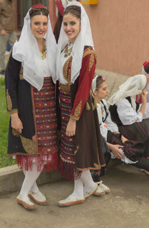 folk music: Pozarevac, Serbia-May 2, 2016: Girls in   serbian folk  costume  smiling  on  folk  music  festival in city called Pozarevac  on  spring