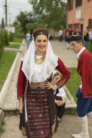 folk music: Pozarevac,Serbia-May 2,2016: Girl in   serbian folk  costume  smiling  on  folk  music  festival in city called Pozarevac  on  spring