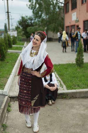 folk music: Pozarevac, Serbia-May 2, 2016: Girl in   serbian folk  costume  smiling  on  folk  music  festival in city called Pozarevac  on  spring