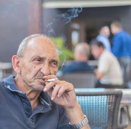 dude: old dude smoking
