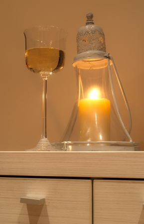 fussy: Oriental Candle Holder with glass of wine beside