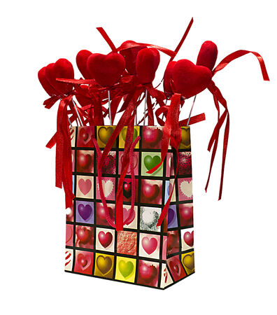 Red paper shopping bag with white hearts on stick photo
